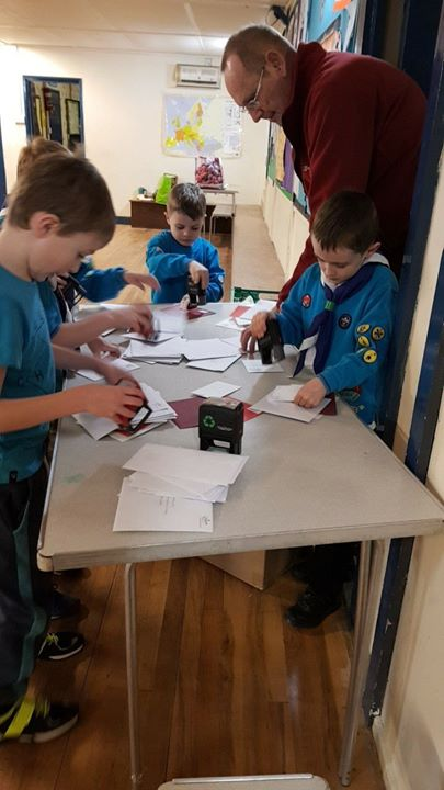Our army of Beavers are helping with stamping the Christmas post! #goblueninjasgo #betterthantheroyalmail